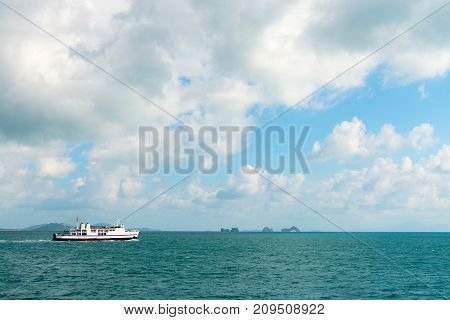 White Ferry In Seascape With Green Islands On Horizon