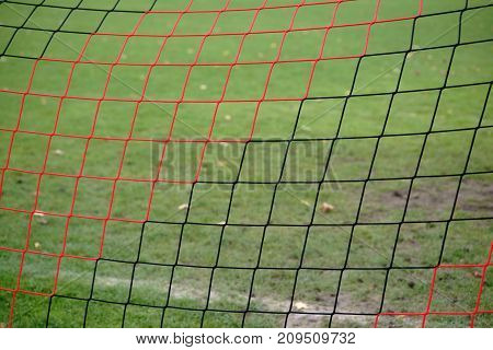 The net of a football goal over close-up.