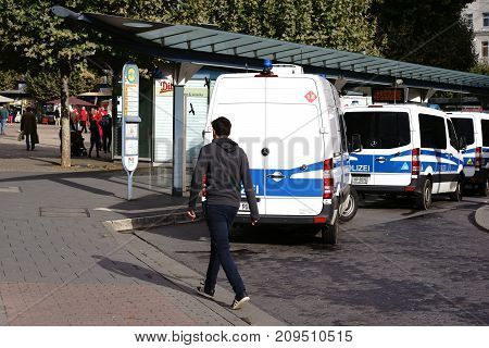 MAINZ, GERMANY - OCTOBER 03: Police car at a bus stop station on the day of German Unity on October 03, 2017 in Mainz.