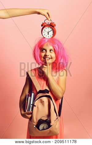 Pupil In School Uniform With Pink Wig And Red Alarm