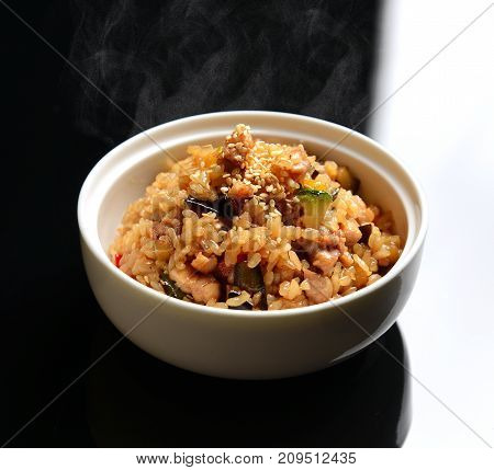 Healthy food homemade Chinese fried rice with vegetables, chicken and fried eggs served in deep plate hot