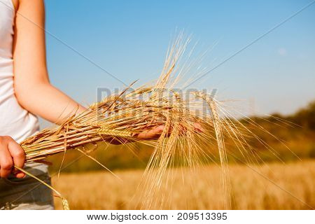 Image of girl in white T-shirt with spikelets