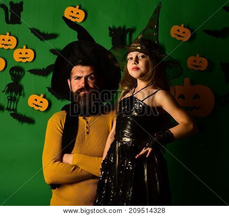 Wizard And Little Witch In Black Hats. Father And Daughter