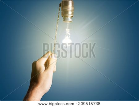 Hand lamp bulb turning objects background glass