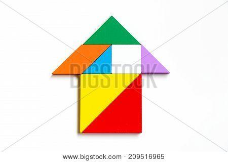 Colorwood tangram puzzle on arrow or house shape on white background