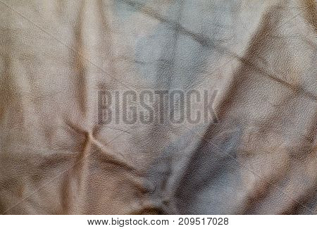 Close Up At Crumpled Stain Brown Leather Texture Background