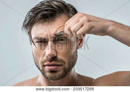 Man Plucking Eyebrows