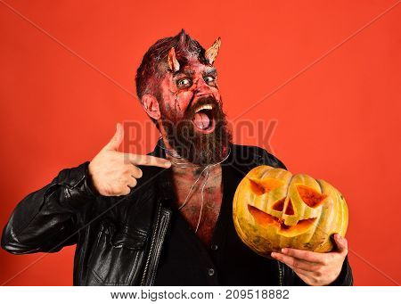 Devil Or Monster With October Decorations. Demon With Smiling Face