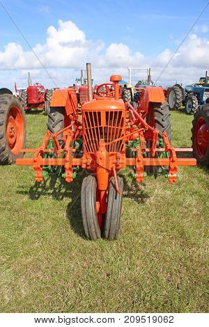 Vintage red tractor standing in a field