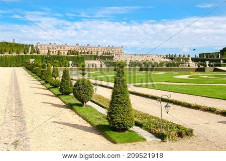 The gardens of the royal Palace of Versailles near Paris in France on a beautiful summer day