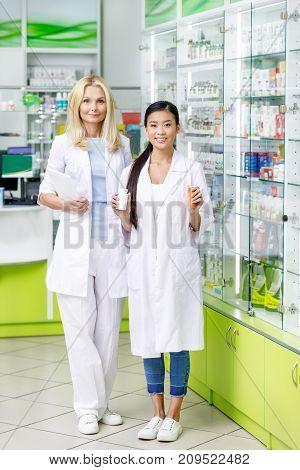 Multiethnic Pharmacists In Drugstore