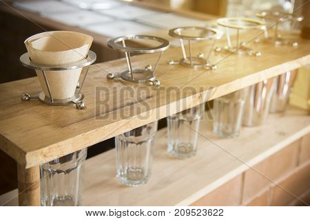 Coffee drip set.coffee brewing gadgets on wooden bar in coffee shop