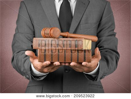 Wooden male hands wood hammer judge table