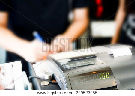 Blur cashier counter in the supermarketCashier at a supermarket checkout in a department store