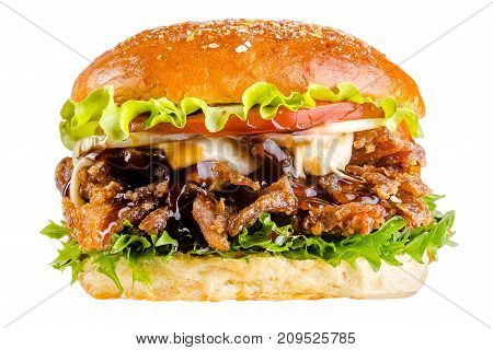 Delicious appetizing burger hamburger with sesame, with veal beef pork chop steak, with bacon, with onion, on a wooden board, with garlic and fresh herbs, tomato sauce and Parmesan cheese. isolated on white background