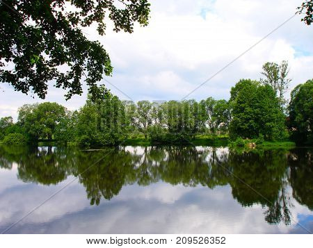Russian nature. Green forest. The green woods. Lake in summer forest. Green trees reflected in the lake in Russian. Summer landscape. Russian forest in summer in Sunny day. Nature Reserve. The lake in Russia