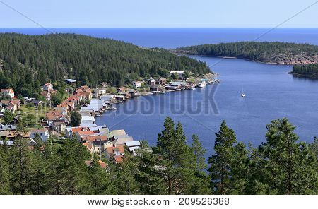 Ulvon village and harbor seen from above from a nearby hill. Sunny day in the part of the High Coast World Heritage. Seaside.