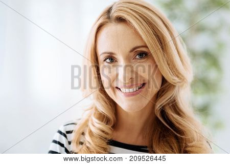 Sincere emotions. Portrait of a happy cheerful positive woman smiling and looking at you while showing her emotions