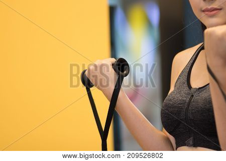 young woman execute exercise in fitness center. female athlete training in gym. sporty asian girl working out in health club.