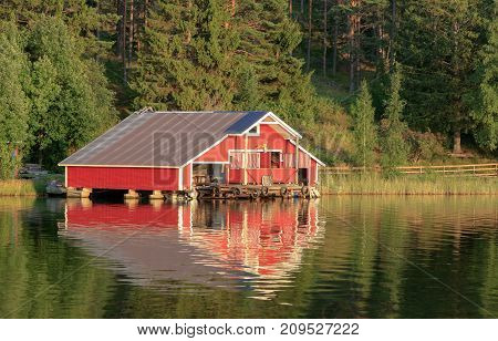 HIGH COAST WORLD HERITAGE, SWEDEN ON AUGUST 05. View of a classic red cabin, rorbu on August 05, 2009 in High Coast World Heritage, Sweden. Editorial use.