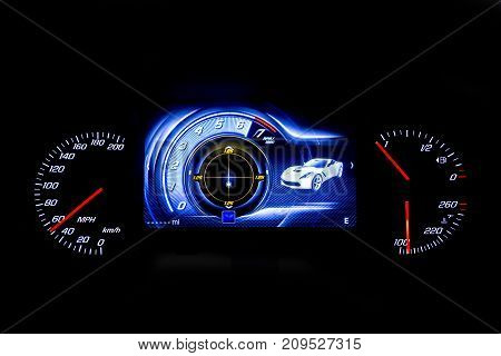 Sofia, Bulgaria - 17, December 2016: Modern light car mileage (dashboard milage) isolated on a black background. New display of a modern car. MPH fuel and temperature (Fahrenheit) digital indicators.