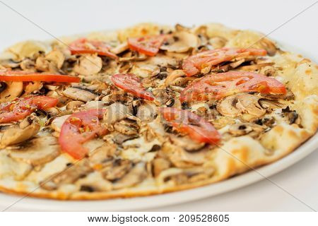 Vegetarian Pizza With Champignons And Tomatoes