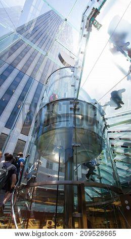 New York City Usa - July 10 2015: Apple Store cube on 5th Avenue. Apple logo at Apple store on 5th ave. the glass front of the store looking up at logo in Manhattan.