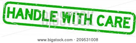 Grunge green handle with care square rubber seal stamp on white background