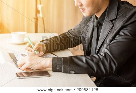 businessman working on documents graphic concentrated with mobile phone on the table at office.