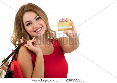 shopping woman with credit card isolated on white.