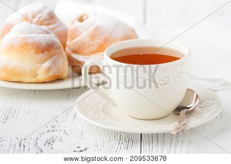 Romantic tropical breakfast Danish pastry coffee on table