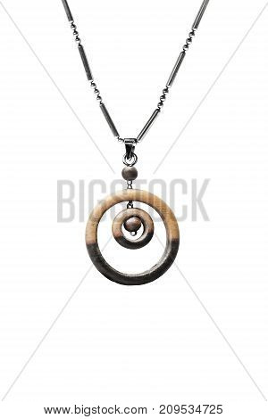 Wooden ethnic pendant hanging on silver chain isolated over white