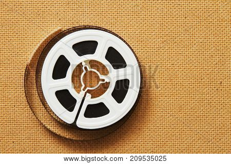 a single 8 mm film reel with nobody.