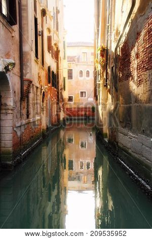 A quiet, empty canal in Venice, Italy
