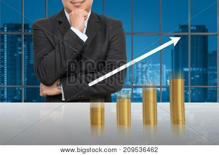 Businessman with gold coins growth up in office conference meeting room on photo blurred cityscape Business investment growth concept, 3D illustration