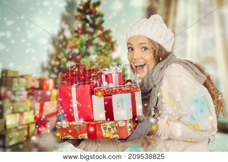 Christmas girl young gifts new year red background