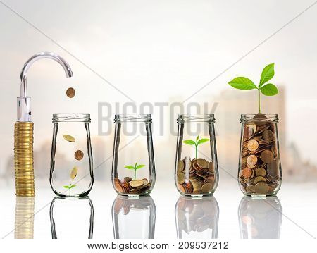 Faucet putting Gold coins and seed in clear bottle on cityscape photo blurred cityscape backgroundBusiness investment growth concept, 3D illustration