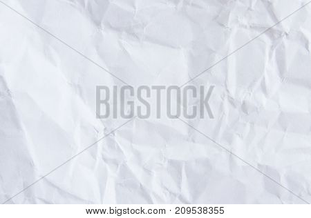 a blank empty crumpled white paper background.