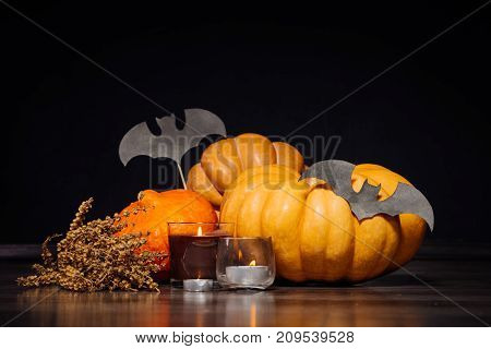 to create an atmosphere of Halloween lay pumpkins and candles burning
