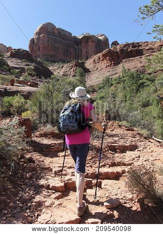 SEDONA, ARIZONA, OCTOBER 11. The Cathedral Rock Trail on October 11, 2017, near Sedona, Arizona. A Woman Hikes the Cathedral Rock Trail Toward Famous Cathedral Rock Near Sedona in Arizona.