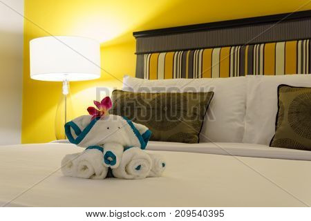 Close Up, Towels Are Folded Into Elephants Shape For Bathroom Accessories Preparation On The Bed In
