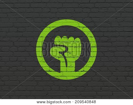 Politics concept: Painted green Uprising icon on Black Brick wall background