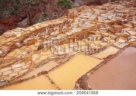 Salinas de Maras - salt evaporation ponds near town of Maras in Peru. These salt pans are in use since Inca times. poster
