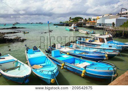 Boats anchored at Puerto Ayora on Santa Cruz Island Galapagos National Park Ecuador. Puerto Ayora is the most populous town in the Galapagos Islands.