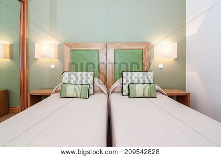 Modern bedroom with double bed. Interior luxury