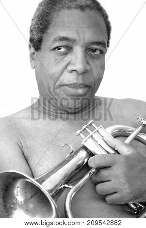 African american jazz musician expressions with his flugelhorn indoors.