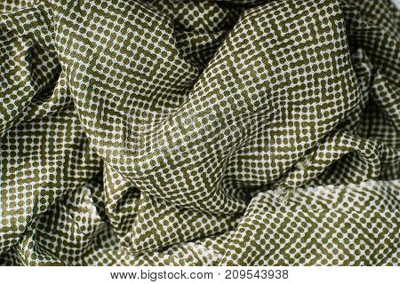 green polka dots fabric background for texture and design