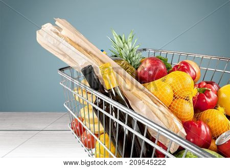 Shopping cart full green background colorful bag