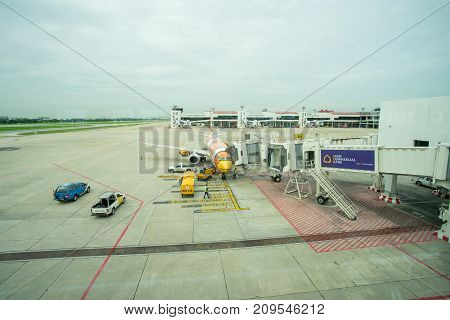 BANGKOK THAILAND  21 JULY 2017: NOKAIR airline loading cargo on the plane at the gate in Don Mueang international airport (DMK)