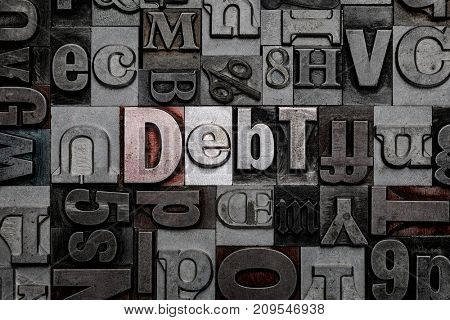 The word Debt made from old metal letterpress letters